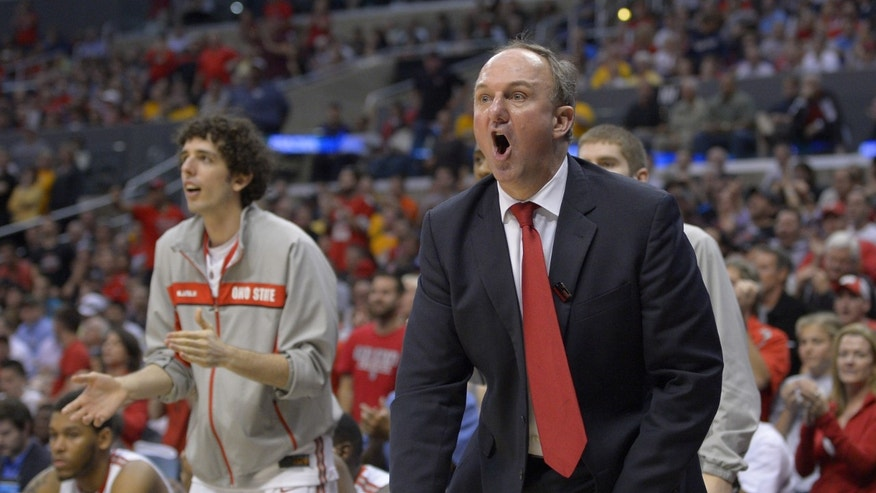 FILE - In this March 30, 2013 file photo, Ohio State coach Thad Matta reacts during the second half of the West Regional final against Wichita State in the NCAA mens college basketball tournament in Los Angeles. For a change, Matta doesn't have to introduce a bunch of newcomers to college-level hoops this fall. Led by Aaron Craft and Lenzelle Smith Jr., Ohio State has a veteran crew that includes two seniors and seven juniors from a 29-win squad that came within a whisper of its second straight trip to the Final Four. (AP Photo/Mark J. Terrill, File)