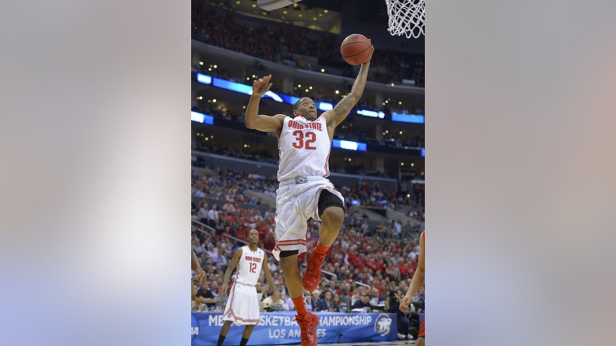 FILE - In this March 28, 2013 file photo, Ohio State's Lenzelle Smith, Jr., scores against Arizona during the West Regional semifinal in the NCAA college basketball tournament in Los Angeles. Led by Smith and Aaron Craft, Ohio State has a veteran crew that includes two seniors and seven juniors from a 29-win squad that came within a whisper of its second straight trip to the Final Four. (AP Photo/Mark J. Terrill, File)