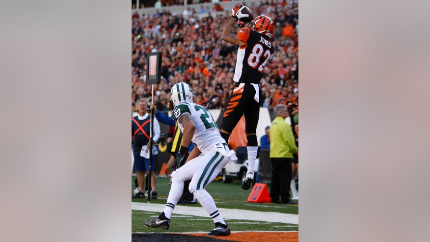 Cincinnati Bengals wide receiver Marvin Jones (82) catches a nine-yard touchdown pass against New York Jets cornerback Dee Milliner (27) in the first half of an NFL football game, Sunday, Oct. 27, 2013, in Cincinnati. (AP Photo/David Kohl)