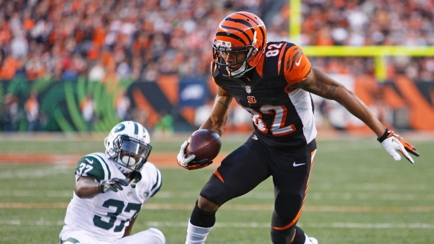 Cincinnati Bengals wide receiver Marvin Jones (82) runs past New York Jets free safety Jaiquawn Jarrett (37) for a six-yard touchdown reception in the second half of an NFL football game, Sunday, Oct. 27, 2013, in Cincinnati. (AP Photo/David Kohl)