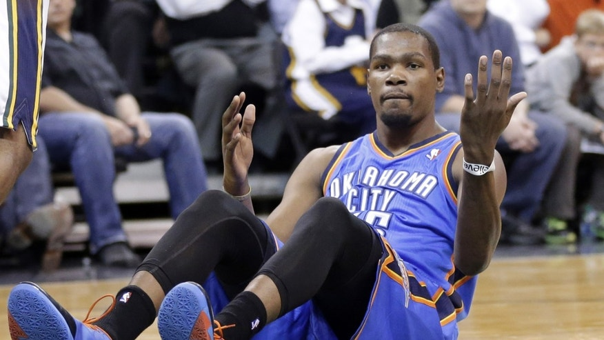 Oklahoma City Thunder's Kevin Durant looks for a call after driving to the basket in the second quarter during an NBA basketball game against the Utah Jazz, Wednesday, Oct. 30, 2013, in Salt Lake City.  (AP Photo/Rick Bowmer)