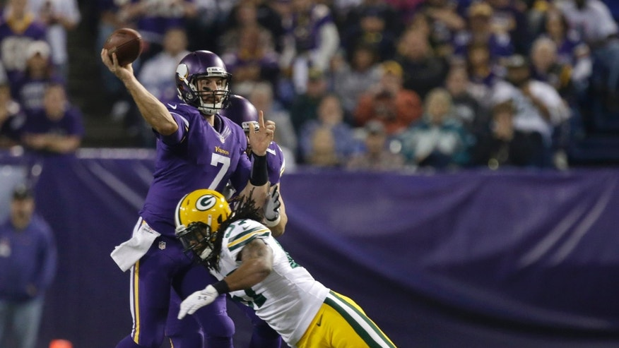 Minnesota Vikings quarterback Christian Ponder (7) throws a pass against Green Bay Packers inside linebacker Jamari Lattimore (57) in the first half of an NFL football game, Sunday, Oct. 27, 2013, in Minneapolis. (AP Photo/Jim Mone)