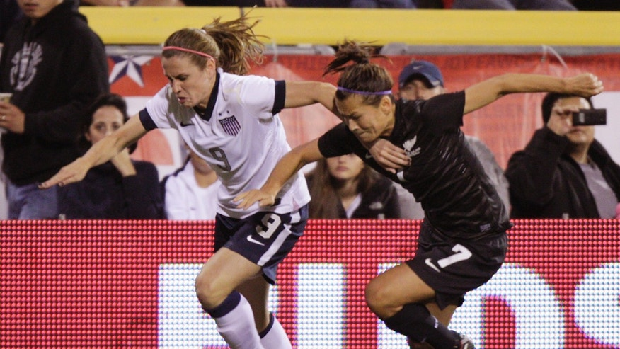 United States' Heather O'Reilly, left, and New Zealand's Ali Riley chase a loose ball during the first half of an international friendly soccer match Wednesday, Oct. 30, 2013, in Columbus, Ohio. (AP Photo/Jay LaPrete)