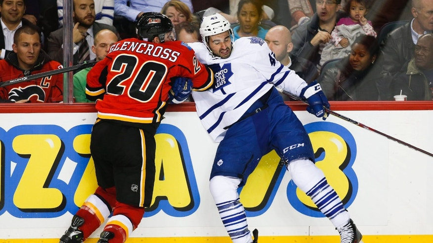 Toronto Maple Leafs' Nazem Kadri, right, is checked by Calgary Flames' Curtis Glencross during the second period of an NHL hockey game in Calgary, Alberta, Wednesday, Oct. 30, 2013. (AP Photo/The Canadian Press, Jeff McIntosh)