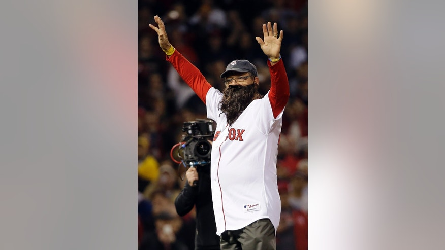 Carlton Fisk wears a beard as he throws out the ceremonial first pitch before Game 6 of baseball's World Series between the Boston Red Sox and the St. Louis Cardinals Wednesday, Oct. 30, 2013, in Boston. (AP Photo/David J. Phillip)