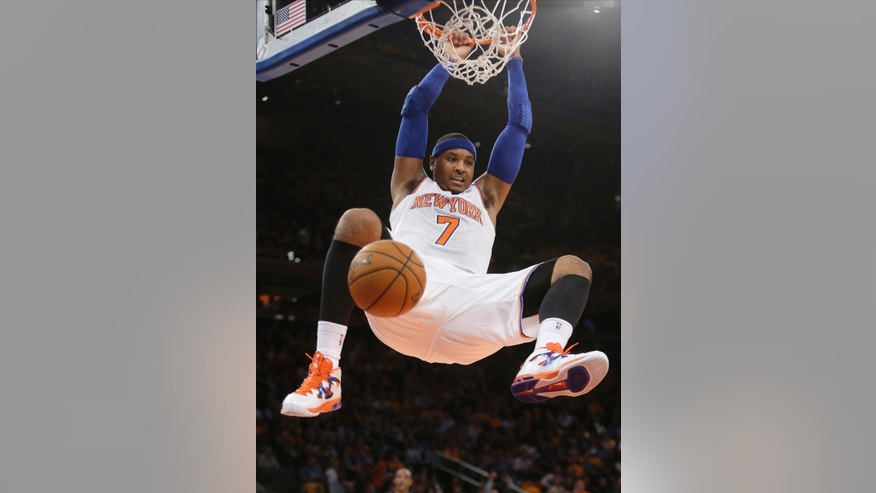 New York Knicks' Carmelo Anthony dunks during the first half of an NBA basketball game against the Milwaukee Bucks on Wednesday, Oct. 30, 2013, in New York. (AP Photo/Frank Franklin II)