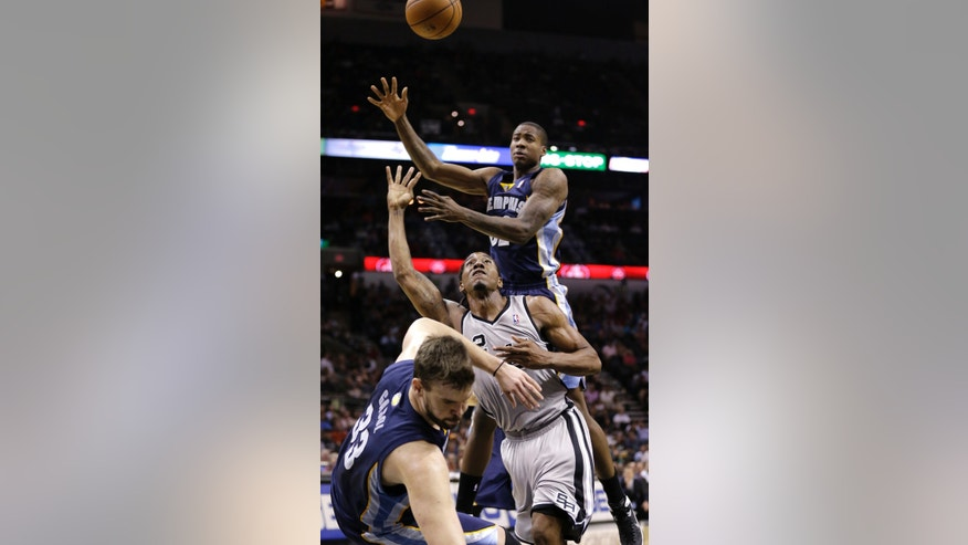 San Antonio Spurs' Kawhi Leonard (2) crashes into Memphis Grizzlies' Marc Gasol (33), of Spain, as he tries to shoot during the second half of an NBA basketball game, Wednesday, Oct. 30, 2013, in San Antonio. Grizzlies' Ed Davis is at top. (AP Photo/Eric Gay)