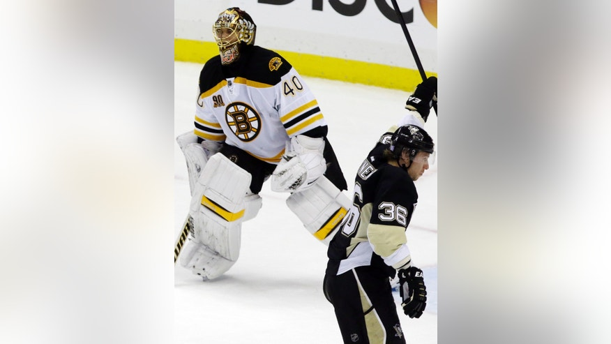 Pittsburgh Penguins' Jussi Jokinen (36) celebrates after putting the puck past Boston Bruins goalie Tuukka Rask (40) in the third period of an NHL hockey game in Pittsburgh on Wednesday, Oct. 30, 2013. The Penguins won 3-2. (AP Photo/Gene J. Puskar)