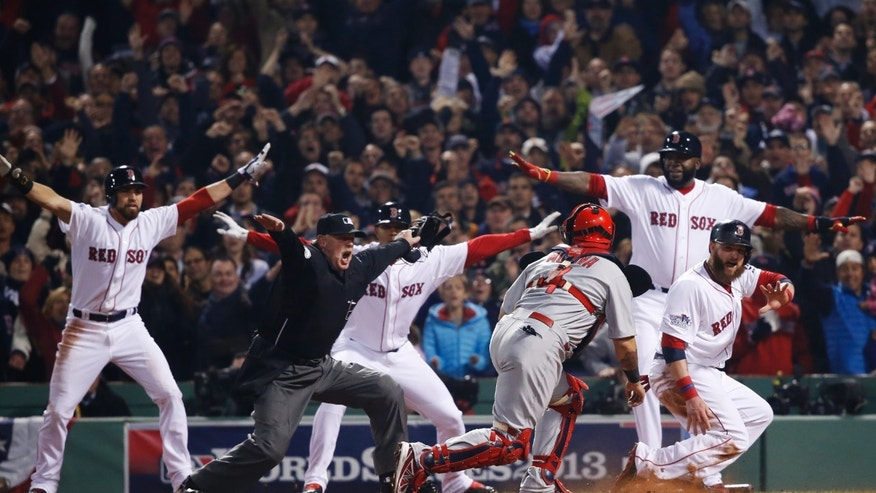 St. Louis Cardinals catcher Yadier Molina looks back as home plate umpire Jim Joyce calls Boston Red Sox's Jonny Gomes safe on a three-run double by Shane Victorino during the third inning of Game 6 of baseball's World Series on Wednesday, Oct. 30, 2013, in Boston. At rear from left are Boston's Jacoby Ellsbury, Xander Bogaerts and David Ortiz. (AP Photo/Elise Amendola)