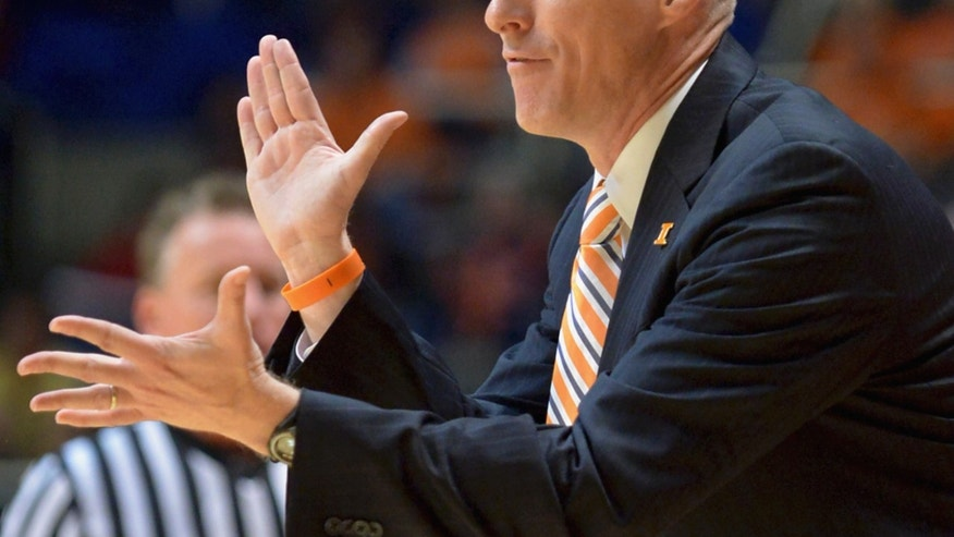 In this Oct. 24, 2013 photo, Illinois head coach John Groce cheers on his team during an NCAA exhibition basketball game against McKendree at the State Farm Center in Champaign, Ill. Last year, in his first season at Illinois, Groce had a 23-13 record, an appearance in the NCAA tournament, and a win in its opening game. With this season's opener just over a week away, no one, not even Groce, knows just what to expect. The team that will open the season Nov. 8 against Alabama State won't look anything like Groce's first Illini team. (AP Photo/The News-Gazette, Robin Scholz) MANDATORY CREDIT