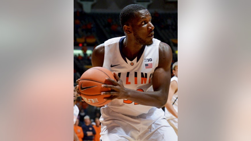 In this Oct. 24, 2013 photo, Illinois junior center Nnanna Egwu looks to pass during an NCAA exhibition basketball game against McKendree at the State Farm Center in Champaign, Ill. Illinois opens its season in Champaign Nov. 8 against Alabama State. Head coach John Groce expects to lean heavily on Egwu who is the only experienced big man on the team. (AP Photo/The News-Gazette, Robin Scholz) MANDATORY CREDIT