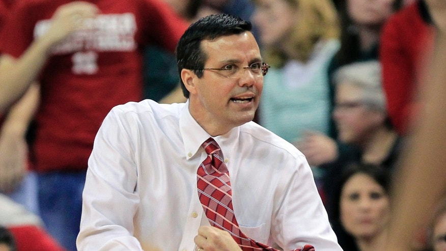 FILE In this Feb. 16, 2013 file photo, Nebraska coach Tim Miles gestures to his players in an NCAA college basketball game against Michigan State, in Lincoln, Neb. Nebraska will have one of the best venues in the nation with the opening of the $179 million Pinnacle Bank Arena, but whether the product on the floor is better in coach Tim Miles' second season is a mystery. (AP Photo/Nati Harnik, File)