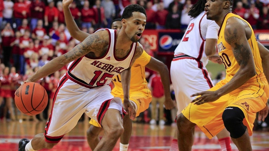 FILE - In this March 6, 2013 file photo, Nebraska's Ray Gallegos (15) drives past Minnesota's Andre Ingram, right, in an NCAA college basketball game in Lincoln, Neb.  Nebraska will have one of the best venues in the nation with the opening of the $179 million Pinnacle Bank Arena, but whether the product on the floor is better in coach Tim Miles' second season is a mystery. (AP Photo/Nati Harnik, File)