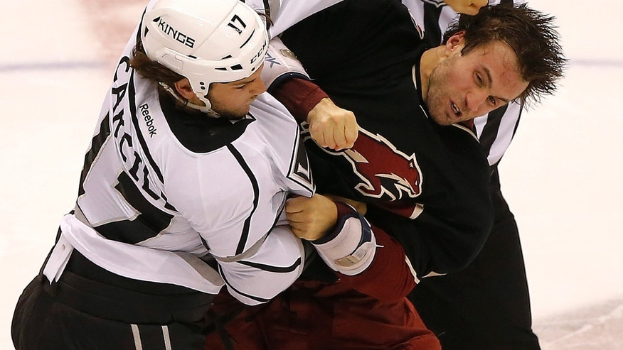Phoenix Coyotes' Kyle Chipchura, right, fights with Los Angeles Kings' Daniel Carcillo during the second period of an NHL hockey game, Tuesday, Oct. 29, 2013, in Glendale, Ariz. (AP Photo/Matt York)
