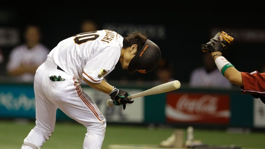 Yomiuri Giants' Takayuki Terauchi is hit by a pitch by Rakuten Eagles pitcher Sho Miyagawa in the fourth inning of Game 4 of baseball's Japan Series at Tokyo Dome in Tokyo, Wednesday, Oct. 30, 2013. (AP Photo/Toru Takahashi)
