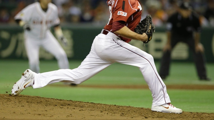 Rakuten Eagles starter Jim Heuser delivers a pitch against the Yomiuri Giants during Game 4 of baseball's Japan Series at Tokyo Dome in Tokyo, Wednesday, Oct. 30, 2013. (AP Photo/Toru Takahashi)