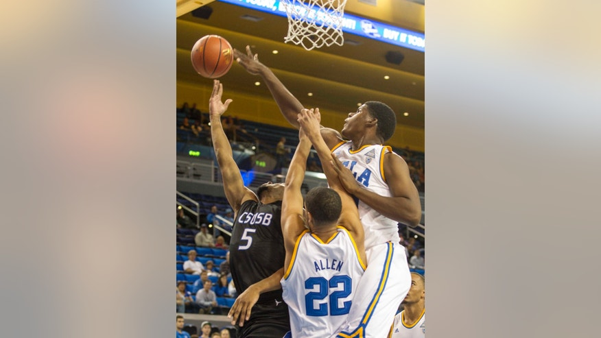 Cal State San Bernardino's Donte Medder (5) goes up against UCLA's Noah Allen (22) and Evan Jenkins, right, in the first half of an NCAA college exhibition  basketball game on Wednesday, Oct. 30, 2013, in Los Angeles. (AP Photo/Ringo H.W. Chiu)