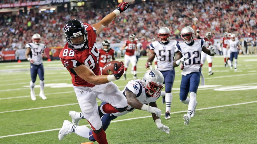 FILE - In this Sept. 29, 2013, file photo, Atlanta Falcons tight end Tony Gonzalez (88) runs into the end zone for a touchdown past New England Patriots cornerback Alfonzo Dennard (37) during the first half of an NFL football game in Atlanta.  The trade deadline has passed and Gonzalez knows where he'll be finishing his career. And unless the Falcons pull off an improbable turnaround, his 17th season will end like the previous 16, without a ring.(AP Photo/John Bazemore, File)