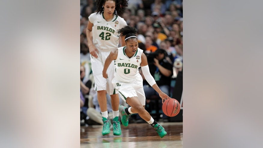 ADVANCE FOR WEEKEND EDITION, NOV. 2-3 - FILE - In this April 1, 2013, file photo, Baylor guard Odyssey Sims (0) dribbles the ball down court as center Brittney Griner (42) follows during the first half in the NCAA Women's Final Four semifinal college basketball game against Stanford in Denver. With Griner now gone to the pros, the Lady Bears will look to Sims for leadership and have a much different look without that huge presence in the post.  (AP Photo/Eric Gay)
