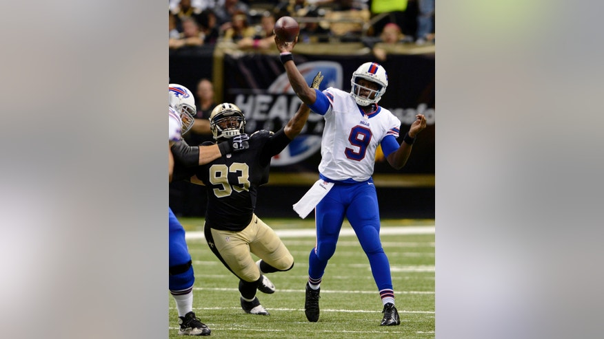 Buffalo Bills quarterback Thad Lewis (9) passes under pressure from New Orleans Saints outside linebacker Junior Galette (93) during the second half of an NFL football game in New Orleans, Sunday, Oct. 27, 2013. (AP Photo/Bill Feig)