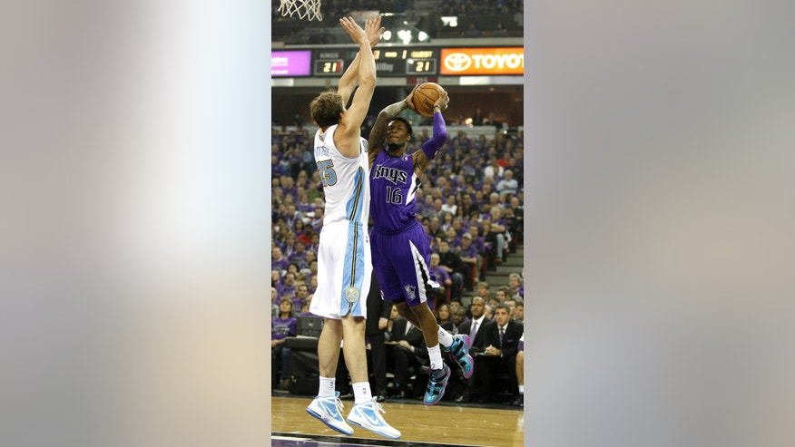 Sacramento Kings guard Ben McLemore, right, drives against Denver Nuggets center Timofey Mozgov ,of Russia, during the first quarter of an NBA basketball game in Sacramento, Calif., Wednesday, Oct. 30, 2013. (AP Photo/Genevieve Ross)