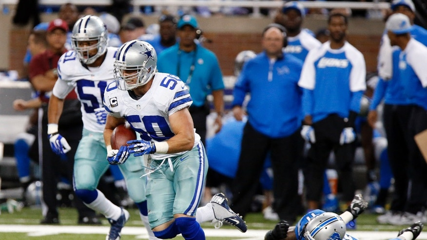 Dallas Cowboys middle linebacker Sean Lee (50) intercepts a Detroit Lions quarterback Matthew Stafford (9) pass as wide receiver Kevin Ogletree lies on the field in the second quarter of an NFL football game in Detroit, Sunday, Oct. 27, 2013. (AP Photo/Duane Burleson)