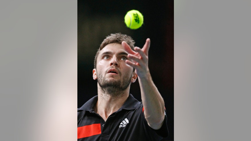 France's Gilles Simon serves to Spain's David Ferrer during their match at the Paris Masters tennis, in the Paris Bercy stadium, Thursday Oct. 31, 2013.(AP Photo/Remy de la Mauviniere)