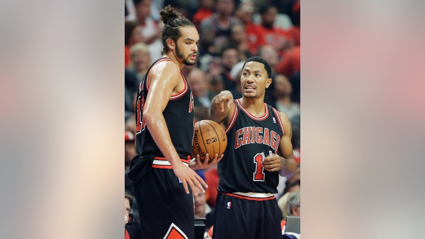 Chicago Bulls guard Derrick Rose, right, talks with center Joakim Noah during the first half of an NBA basketball game against the New York Knicks in Chicago, Thursday, Oct. 31, 2013. (AP Photo/Nam Y. Huh)