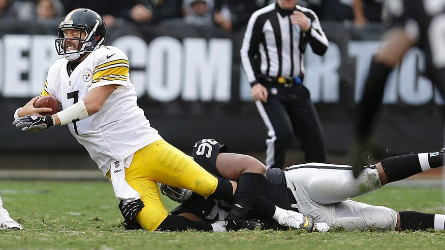 Pittsburgh Steelers quarterback Ben Roethlisberger (7) is sacked by Oakland Raiders defensive tackle Vance Walker during the fourth quarter of an NFL football game in Oakland, Calif., Sunday, Oct. 27, 2013. (AP Photo/Marcio Jose Sanchez)