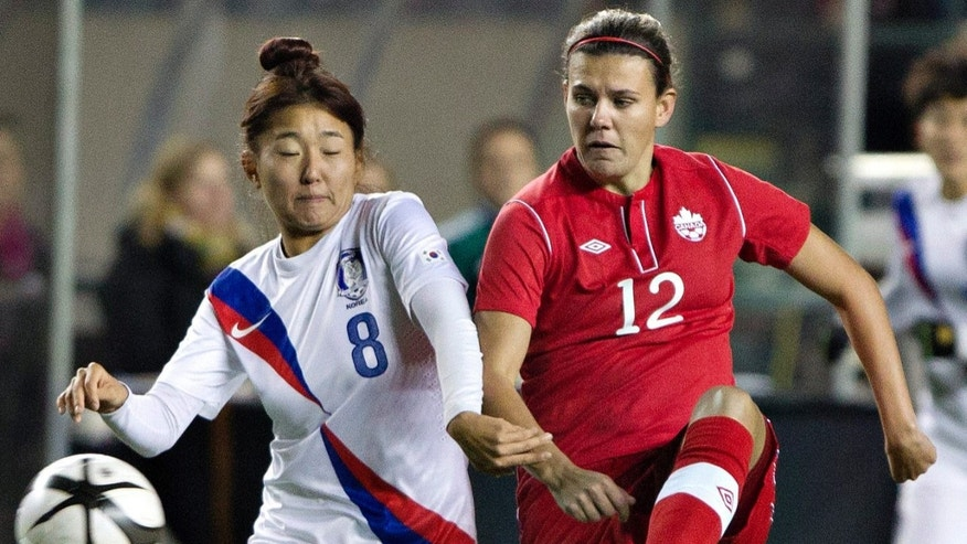 South Korea's So Hyun Cho (8) and Canada's Christine Sinclair (12) vie for the ball during the first half of an international friendly soccer match, Wednesday, Oct. 30, 2013, in Edmonton, Alberta. (AP Photo/The Canadian Press, Jason Franson)