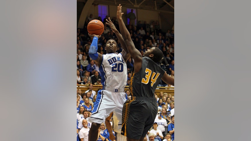 Duke's Semi Ojeleye (20) shoots the ball over Bowie State's Joel Clemmons (34) during the second half of an exhibition NCAA college basketball game in Durham, N.C., Saturday, Oct. 26, 2013. Duke won 103-67.(AP Photo/Karl B DeBlaker)