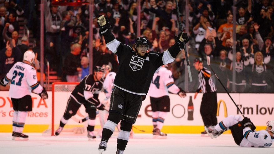 Los Angeles Kings center Anze Kopitar, of Slovenia, celebrates his game-winning goal during overtime of their NHL hockey game against the San Jose Sharks, Wednesday, Oct. 30, 2013, in Los Angeles. (AP Photo/Mark J. Terrill)
