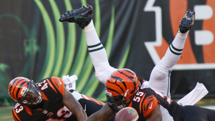 Cincinnati Bengals outside linebacker Vontaze Burfict (55) and strong safety George Iloka (43) break up a pass intended for New York Jets tight end Jeff Cumberland (87) in the end zone in the first half of an NFL football game, Sunday, Oct. 27, 2013, in Cincinnati. (AP Photo/David Kohl)