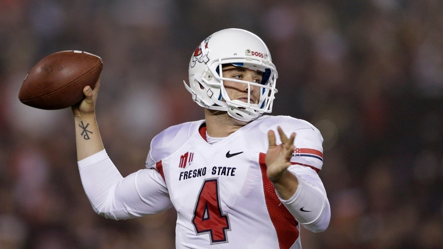 Fresno State quarterback Derek Carr throws a pass while playing against San Diego State during the first half in an NCAA college football game Saturday, Oct. 26, 2013, in San Diego. (AP Photo/Gregory Bull)