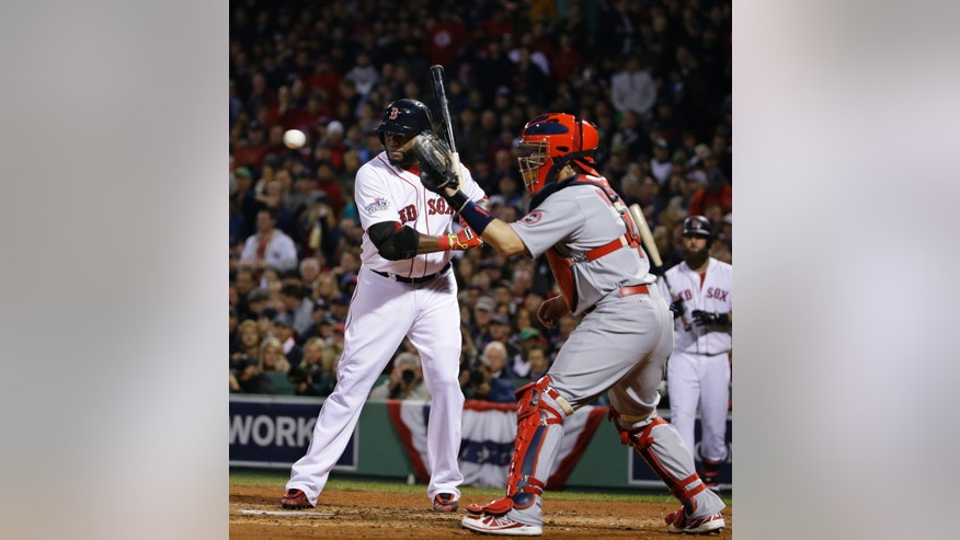St. Louis Cardinals catcher Yadier Molina, right, catches a ball from pitcher Michael Wacha as Boston Red Sox designated hitter David Ortiz is intentionally walked during the third inning of Game 6 of baseball's World Series Wednesday, Oct. 30, 2013, in Boston. (AP Photo/Matt Slocum)