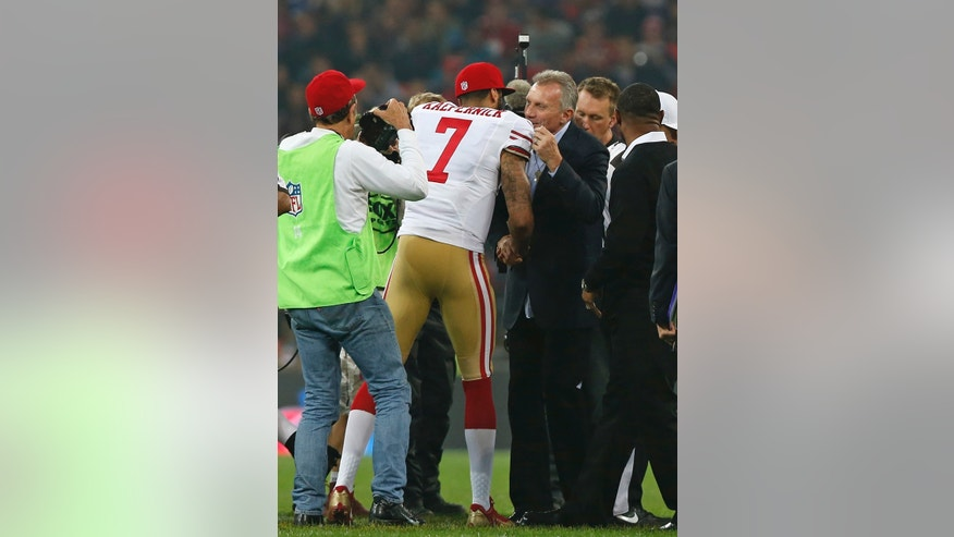 San Francisco 49ers quarterback Colin Kaepernick (7)  is greeted by 49ers legend Joe Montana before the start of the NFL football game between San Francisco 49ers and Jacksonville Jaguars at Wembley Stadium in London, Sunday, Oct. 27, 2013. (AP Photo/Sang Tan)