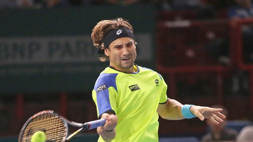Spain's David Ferrer returns the ball to France's Gilles Simon during their match at the Paris Masters tennis, in the Paris Bercy stadium, Thursday Oct. 31, 2013.(AP Photo/Remy de la Mauviniere)