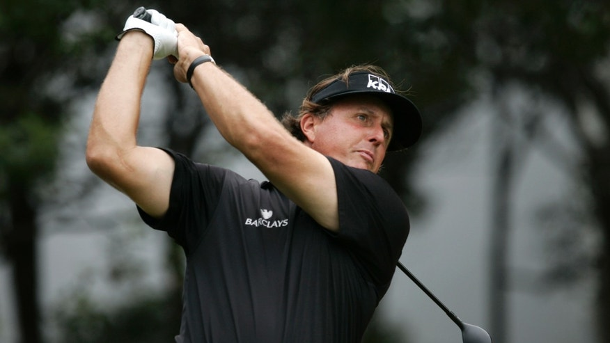 Phil Mickelson of the United States tees off the 5th hole during the Pro-Am event of the HSBC Champions golf tournament, which begins on Thursday, at the Sheshan International Golf Club in Shanghai, China, Wednesday, Oct. 30, 2013. (AP Photo)