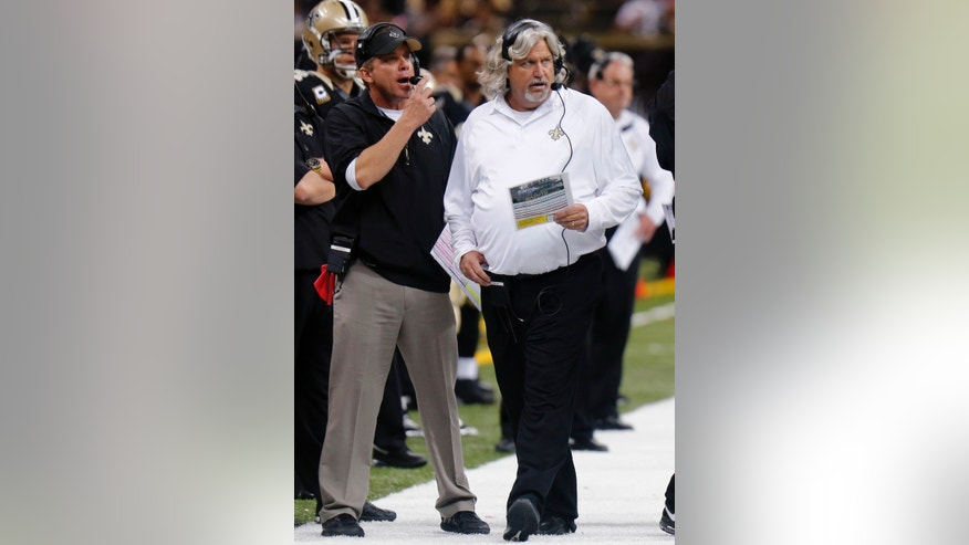 New Orleans Saints head coach Sean Payton, left, and and defensive coordinator Rob Ryan work the sidelines during the second half of an NFL football game against the Buffalo Bills in New Orleans, Sunday, Oct. 27, 2013. (AP Photo/Bill Haber)