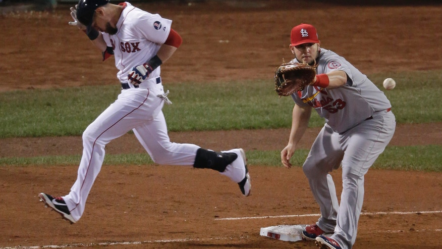 Boston Red Sox's Shane Victorino is safe at first as St. Louis Cardinals' Matt Adams takes the throws during the fifth inning of Game 6 of baseball's World Series Wednesday, Oct. 30, 2013, in Boston. (AP Photo/Charlie Riedel)