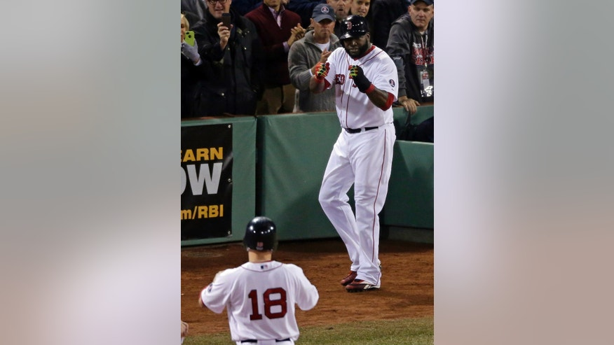 Boston Red Sox's David Ortiz reacts after scoring on a single by Shane Victorino (18) during the fourth inning of Game 6 of baseball's World Series against the St. Louis Cardinals Wednesday, Oct. 30, 2013, in Boston. (AP Photo/Charlie Riedel)