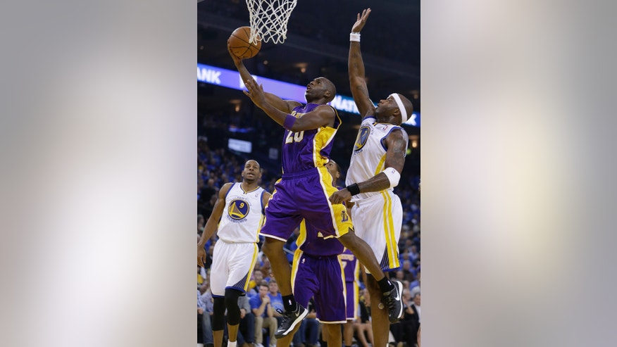 Los Angeles Lakers' Jodie Meeks, left, lays up a shot against Golden State Warriors' Jermaine O'Neal during the first half of an NBA basketball game Wednesday, Oct. 30, 2013, in Oakland, Calif. (AP Photo/Ben Margot)