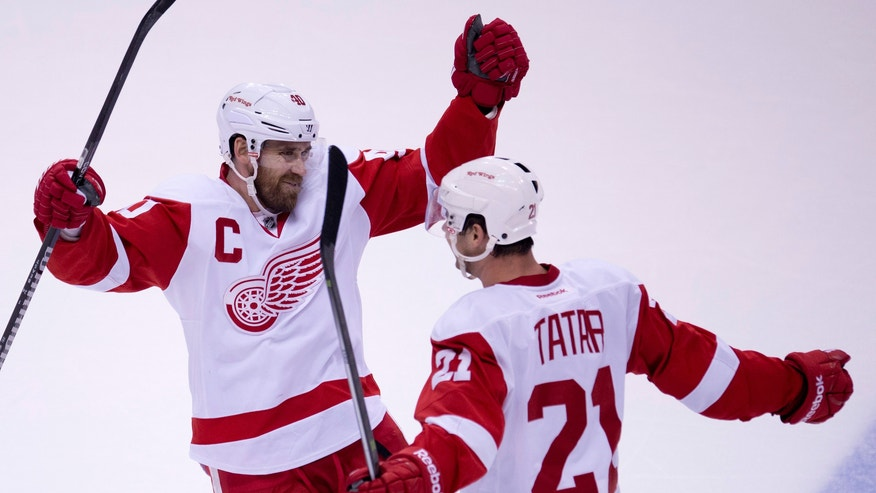 Detroit Red Wings center Tomas Tatar (21) celebrates his goal with center Henrik Zetterberg (40) during the second period of an NHL hockey game  against the Vancouver Canucks in Vancouver, British Columbia, Wednesday, Oct. 30, 2013. (AP Photo/The Canadian Press, Jonathan Hayward)
