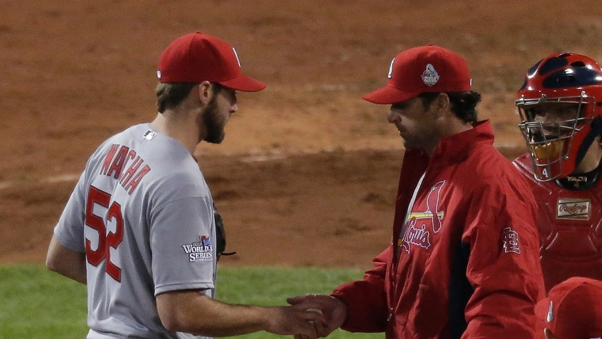St. Louis Cardinals manager Mike Matheny takes starting pitcher Michael Wacha out of the game during the fourth inning of Game 6 of baseball's World Series against the Boston Red Sox Wednesday, Oct. 30, 2013, in Boston. (AP Photo/Charlie Riedel)