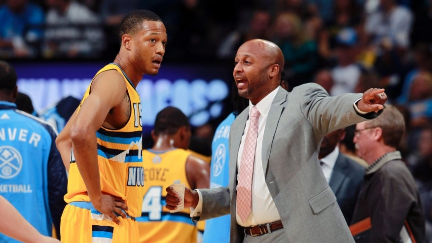 Denver Nuggets forward Anthony Randolph, left, gets direction from head coach Brian Shaw during a timeout against the Portland Trail Blazers in the first quarter of an NBA basketball game in Denver on Friday, Nov. 1, 2013. (AP Photo/David Zalubowski)