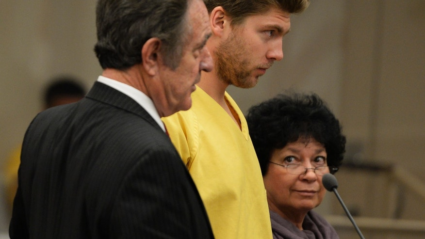 Colorado Avalanche goalie Semyon Varlamov, standing between his attorney Jack Rotole, left, and a Russian interpreter, appears in court in Denver on Thursday, Oct. 31, 2013. Varlamov will be able to travel with the team while prosecutors consider whether he should be charged with assaulting his girlfriend. On Thursday, a judge said Varlamov could be released if he posted $5,000 bond and be allowed to travel with the team but he was ordered to stay away from his girlfriend, among other restrictions. (AP Photo/The Denver Post, RJ Sangosti, Pool)