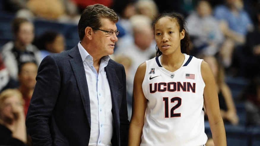 Connecticut coach Geno Auriemma, left, speaks with freshman Saniya Chong during the second half of an NCAA college exhibition basketball game against Gannon, Friday, Nov. 1, 2013, in Storrs, Conn. Connecticut won 101-35. (AP Photo/Jessica Hill)