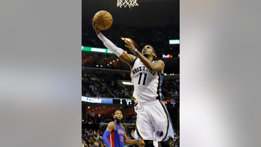 Memphis Grizzlies' Mike Conley (11) goes to the basket during the second half of an NBA basketball game against the Detroit Pistons in Memphis, Tenn., Friday, Nov. 1, 2013. The Grizzlies won 111-108 in overtime. (AP Photo/Danny Johnston)