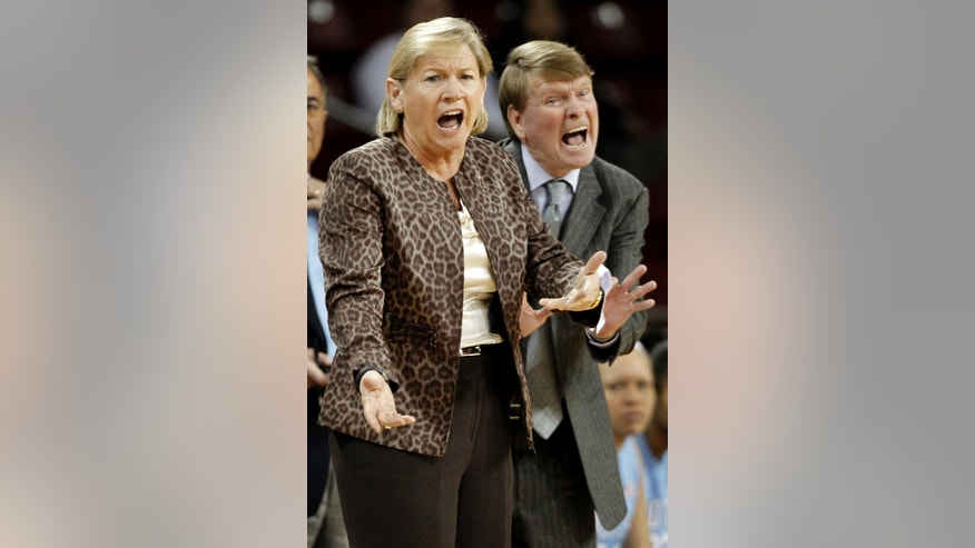 FILE - In this Feb. 7, 2012, file photo, North Carolina coach Sylvia Hatchell, left, and associate head coach Andrew Calder shout at an official during the first half of an NCAA college basketball game against Boston College in Boston. Coach Hatchell, a recently inducted Naismith Hall of Famer, is away from the team while she receives treatment for leukemia. Longtime assistant Calder is leading the program in Hatchell's absence and said the team will follow her plans for this team until she returns.   (AP Photo/Winslow Townson, File)