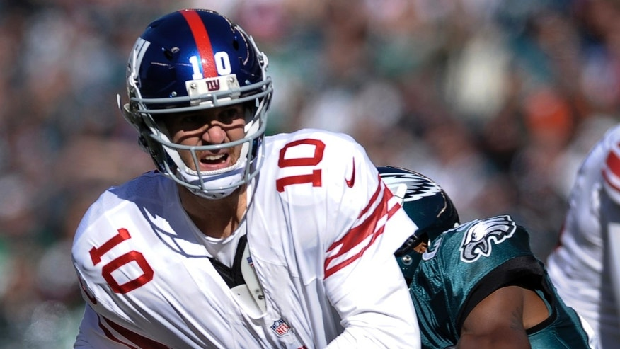 New York Giants quarterback Eli Manning (10) is hit by Philadelphia Eagles' Brandon Boykin (22) during the first half of an NFL football game Sunday, Oct. 27, 2013 in Philadelphia. (AP Photo/Michael Perez)